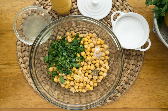 mixing chickpea salad