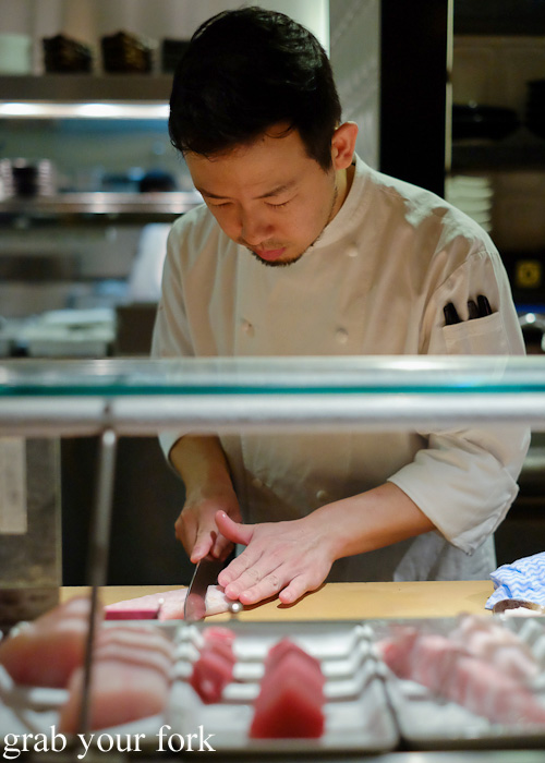 Chef Chase Kojima slicing the alfonsino kinmedia sashimi at Sokyo at The Star, Pyrmont