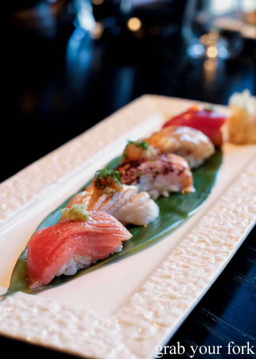 Chu-toro, kingfish belly, salmon belly, scampi and spicy tuna on crispy rice sushi at Sokyo at The Star, Pyrmont