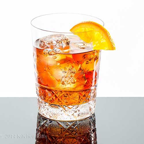 Delmonico Cocktail with orange slice garnish