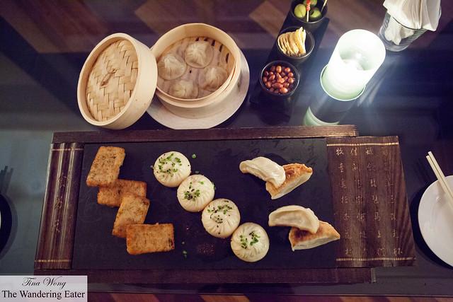 Our lovely spread of Shanghainese snacks - Soup dumplings, pan fried taro cakes, shengjian baos and pan fried dumplings