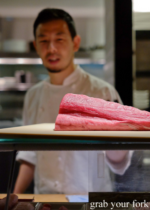 Chef Chase Kojima with a tuna tail at Sokyo at The Star, Pyrmont