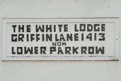 Photo of The White Lodge white plaque
