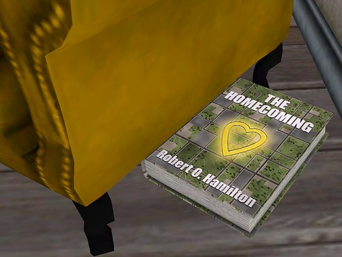 Image Description: Edge of a yellow chair with a book named 'Homecoming' under it.