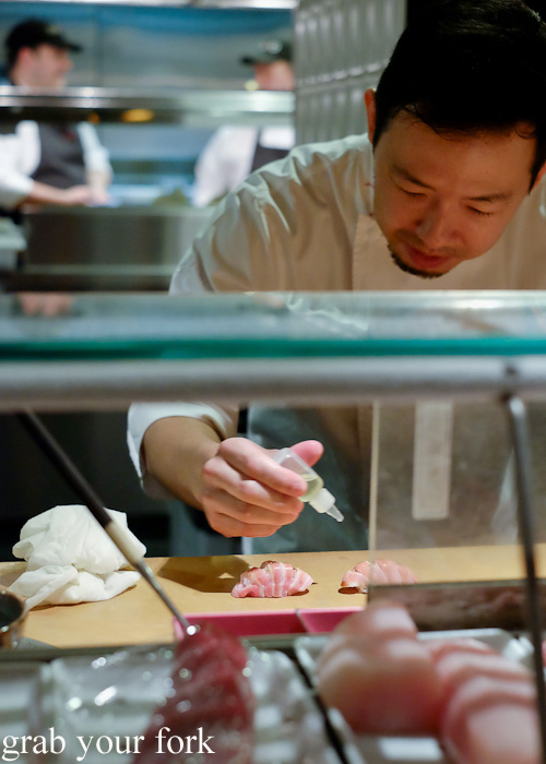 Chef Chase Kojima adding wasabi oil to the ootoro tuna sashimi at Sokyo at The Star, Pyrmont
