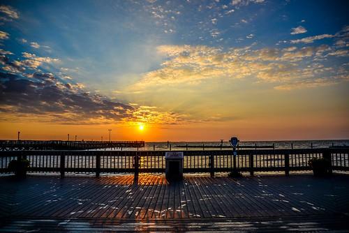 northbeachchesapeake beachboardwalkcalvert county weather sunrise sky beautiful pier beach sand resort pwpartlycloudy maryland photo by angel beil