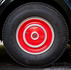 steering wheel(0.0), formula one tyres(0.0), spoke(0.0), automobile(1.0), tire(1.0), automotive tire(1.0), automotive exterior(1.0), wheel(1.0), vehicle(1.0), rim(1.0), alloy wheel(1.0), hubcap(1.0),