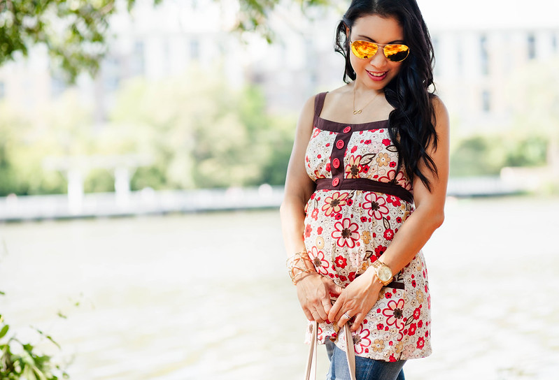 cute & little blog | petite fashion | maternity baby bump second trimester casual summer style | floral strappy tank, ag distressed maternity jeans, tory burch miller sandals, oakley caveat aviators | 22 weeks pregnant
