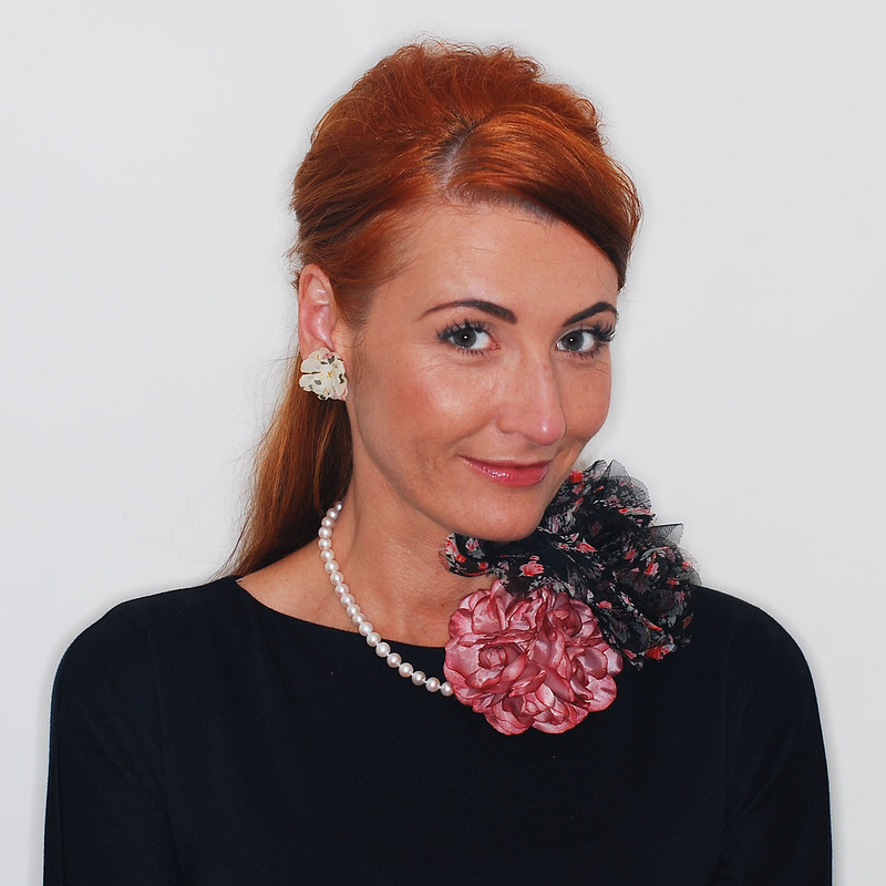 4 Modern Ways to Style a Classic Pearl Necklace | 3. With flower corsages