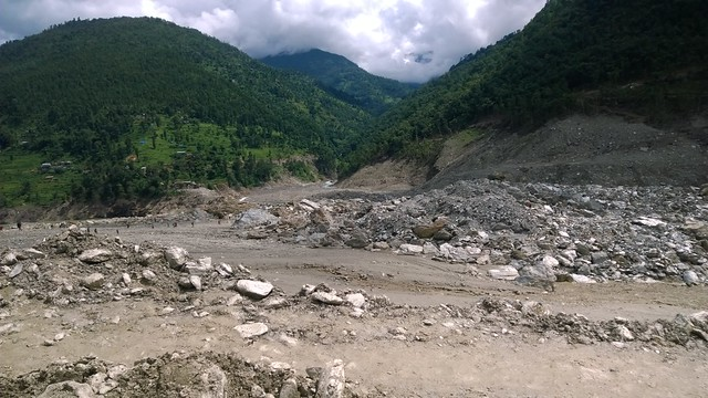 Arniko Highway landslide, porters in distance