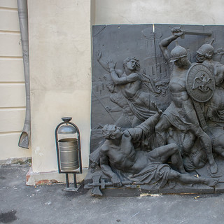 Moscow, courtyard in architecture museum. Rubbish bin, bas-relief