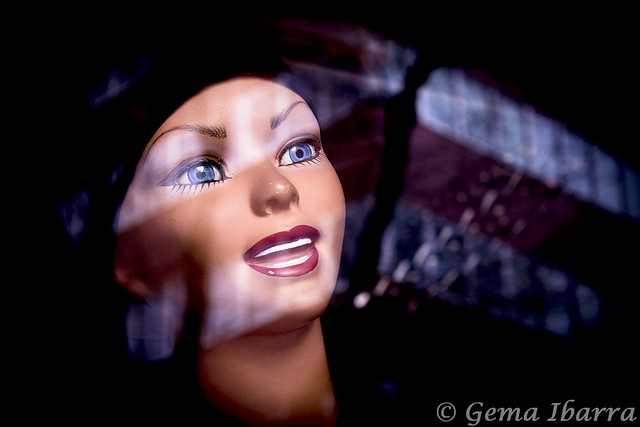 Portrait of mannequin with glass reflections