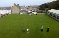 sport venue(0.0), baseball field(0.0), golf club(0.0), estate(0.0), stadium(0.0), lawn game(1.0), grass(1.0), sports(1.0), lawn(1.0),