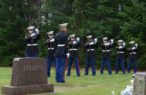 A group of Marines assigned to Naval Base Kitsap-Bangor, Wash., render a three-volley salute in honor of Coast Guard Signalman 1st Class Douglas Munro during a memorial ceremony at Munro's gravesite in Cle Elum, Wash., Sept. 26, 2014. Munro is the only Coast Guardsman to receive the Medal of Honor. (U.S. Coast Guard photo by Petty Officer 3rd Class Katleyn Shearer)