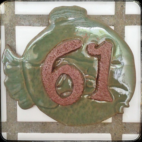 This house number plaque was made for us by the previous owner and given to us as a move-in gift. I finally got around to supergluing it next to the front door. #taiwan #ceramic