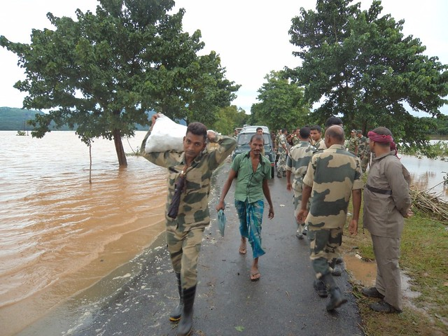 Security personnel in their rescue work in Goalpara.