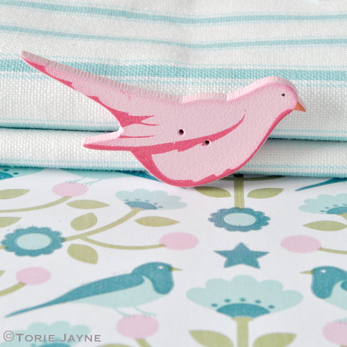 Pink wooden bird button