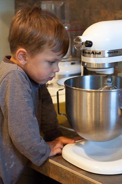 little boy watching mixer