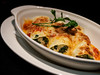 Baked cannelloni - spinach, ricotta cheese, chicken, mushroom,  Bechamel, tomato sauce, parmesan cheese