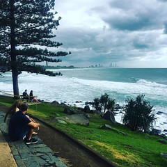 A tad grey today #storm #surf a few #surfers enjoying #cycling #cycle #wymtm #cyclinglife #beachlife #goldcoast