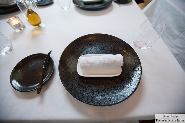 Table setting with a warm hand towel