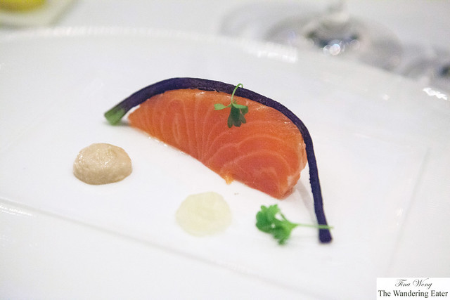 Roast salmon topped with vanilla bean, roast cucumber gel, soy sauce cream