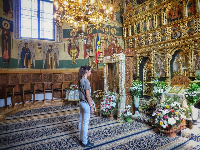A blogger praying in Neamt monastery, Romania
