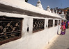 Ringing the Boudhanath prayer bells