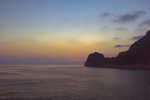 sunset sea mountains reflection water evening seaside greece shore coastline corfu tonight afterglow sunfall