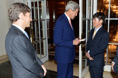 With Assistant Secretary of State for Human Rights Tom Malinowski looking on, U.S. Secretary of State John Kerry greets Shin Dong-hyuk, a survivor of North Korean human rights abuses, before participating in an event highlighting human rights abuses in the Democratic People's Republic of Korea in New York City on September 23, 2014. The Secretary is participating in events in conjunction with the 69th Session of the United Nations General Assembly. [State Department photo/ Public Domain]