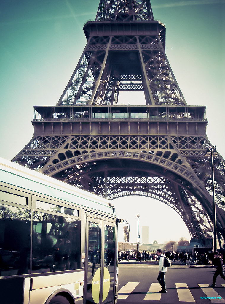 Bus ans street crossing in front of the Tour Eiffel in Paris, France