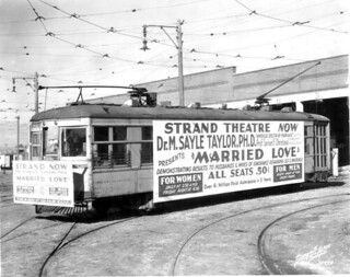 Street car carrying advertisement - Tampa