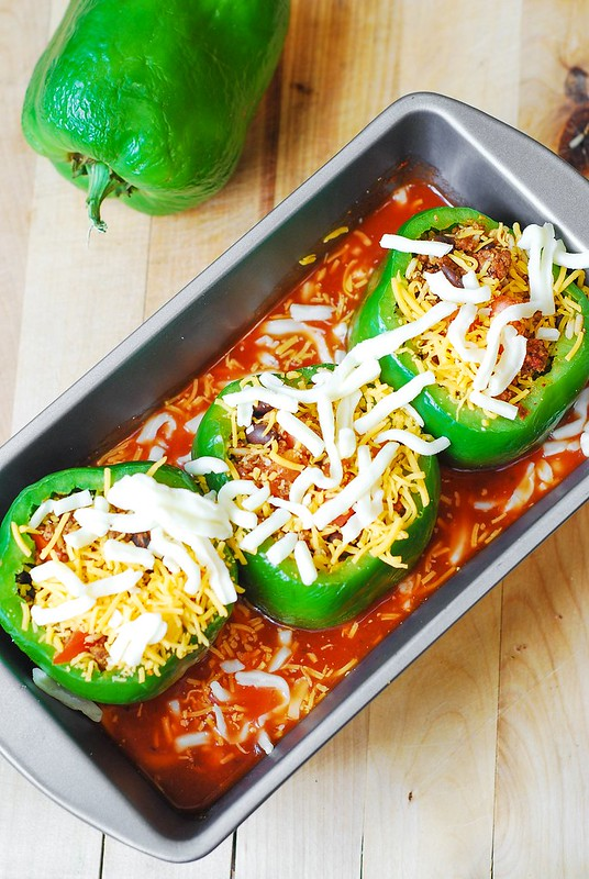 green bell pepeprs stuffed with mexican ground beef black beans rice tomatoes and cheese