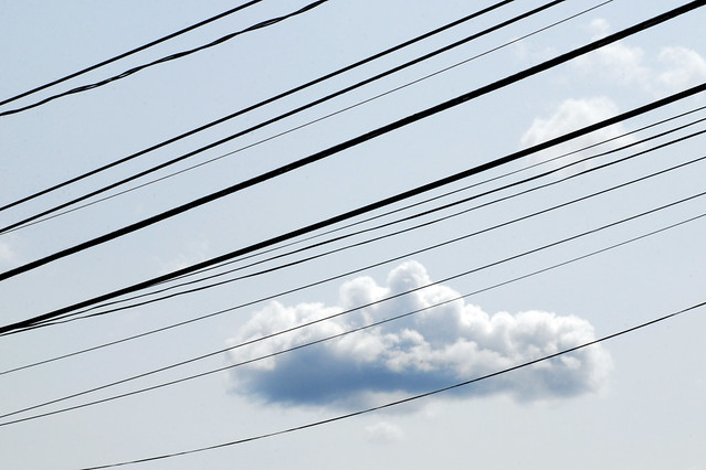 overhead wires and cloud