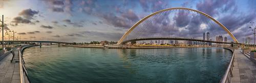 dubai sky clouds bridge canal skyline panorma sunset water river uae