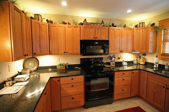 Fully equipped kitchen with custom cabinets and granite counter tops.