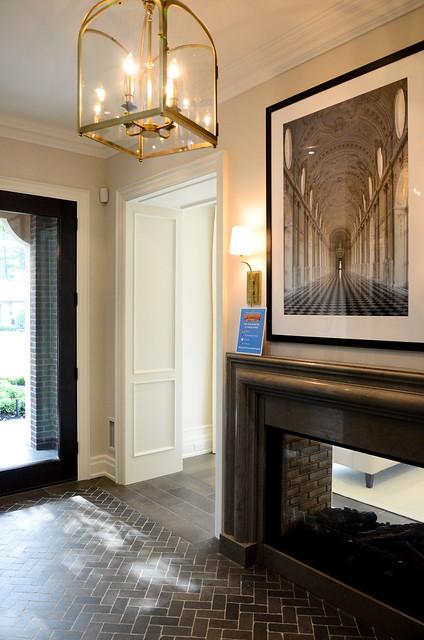 Dark Mud room with herringbone flooring: Princess Margaret Showhome in Oakville by Brian Glucktein