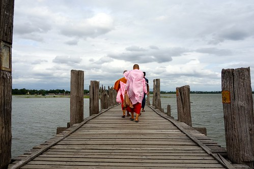 Buddhist nuns walking U-Bein bridge Myanmar