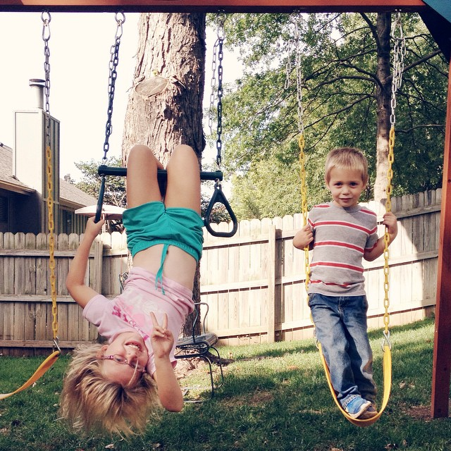 Not following the safety instructions...thank goodness. #kids #fun #swing #upsidedown #peace #daredevils