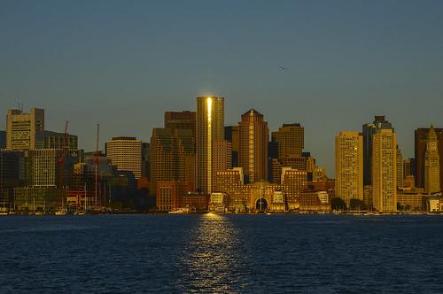 ocean sun boston architecture sunrise buildings reflections harbor rudy bos bostonskyline chiarello bostonharbor oceanfront rudychiarello