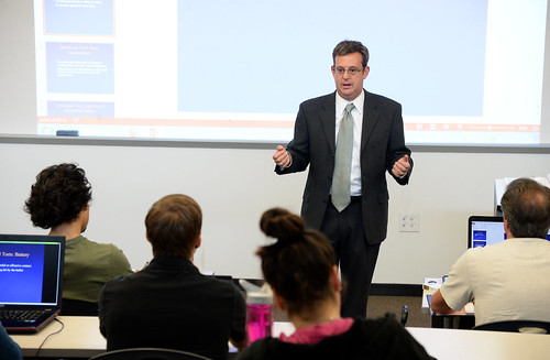 Dr. Brian Elzweig gives a lecture on wrongful acts that can be classified as torts during his Business Law class.