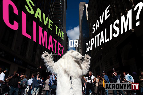A polar bear tries to figure out which one to pick: Climate or Capitalism?