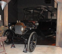 carriage(0.0), automobile(1.0), wheel(1.0), vehicle(1.0), vintage car(1.0), land vehicle(1.0), ford model t(1.0),