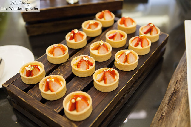Strawberry tarts edged in edible gold
