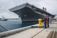 USS Bonhomme Richard (LHD 6) approaches the pier at White Beach Naval Facility in Okinawa, April 6. (U.S. Navy/MCSN Jesse Marquez Magallanes)