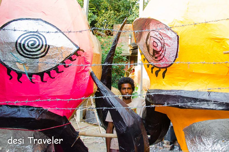 A Ravana makers poses with Ravana heads