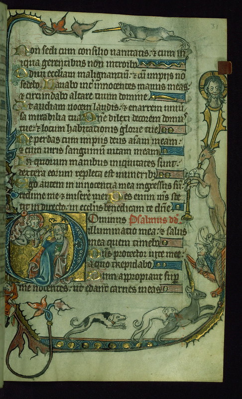 "Psalter-Hours, Initial ""D"" with an enthroned David pointing to his eye before God; dogs attack unicorn in margins, Walters Manuscript W.82, fol. 31r"