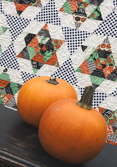 "Camille Roskelley's ""Starlight"" pattern using Witch Hazel fabric from Riley Blakc + Michael Miller Ta Dots = the perfect Halloween quilt to snuggle under."