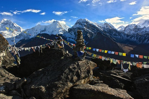 Prayer flags decorate the top of Gokyo Ri