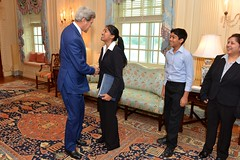 U.S. Secretary of State John Kerry congratulates American Foreign Service Association (AFSA) High School Essay contest winner Nitisha Baronia of San Ramon, California, at the U.S. Department of State in Washington, D.C., on September 29, 2014. [State Department photo/ Public Domain]